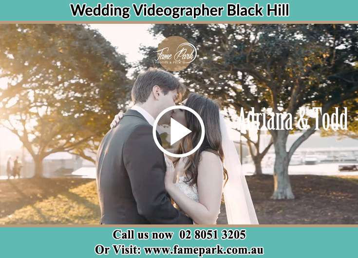 The newly weds kissing at the yard Black Hill NSW 2322