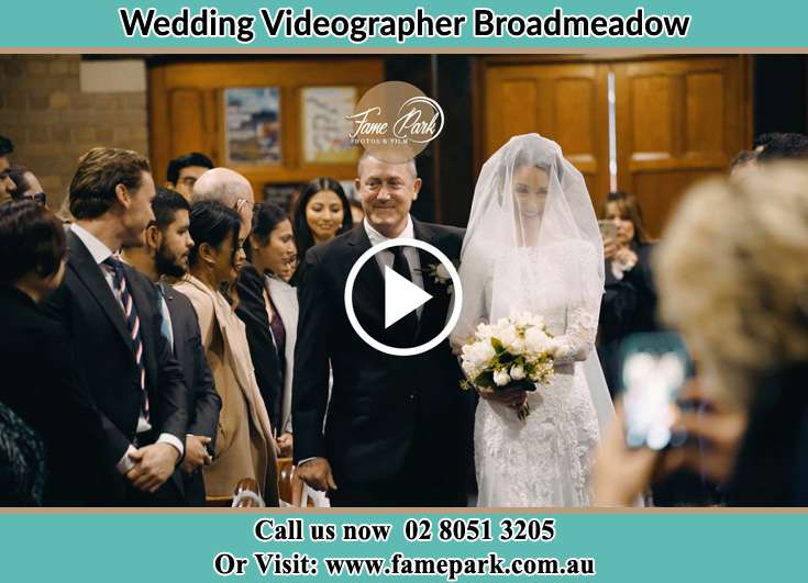 The Bride walking down the aisle with her father Broadmeadow NSW 2292