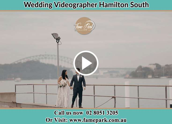 The newly weds walking near the shore Hamilton South NSW 2303