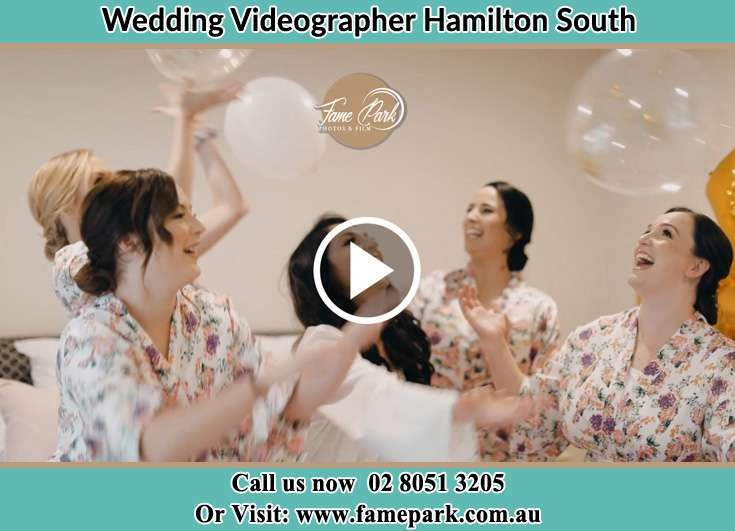 Bride and her secondary sponsors playing balloons Hamilton South NSW 2303