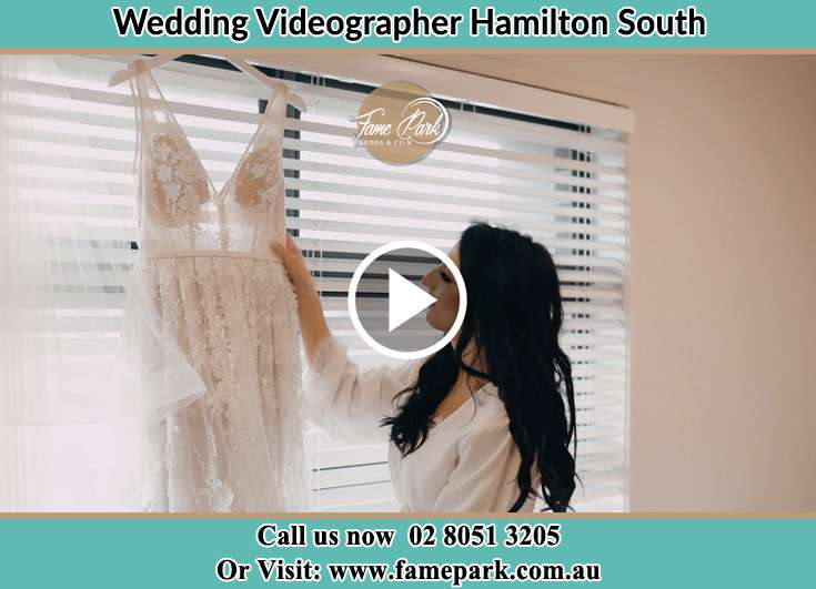 The Bride checking the wedding gown Hamilton South NSW 2303