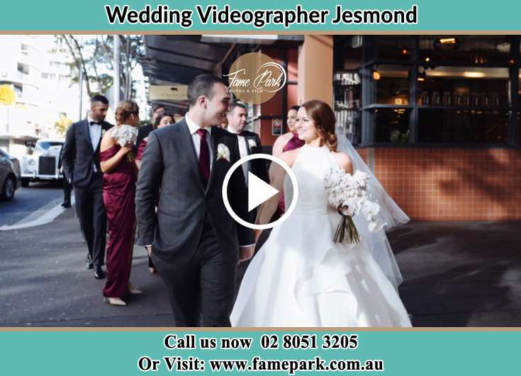 The Groom and the Bride walking in the street Jesmond NSW 2299