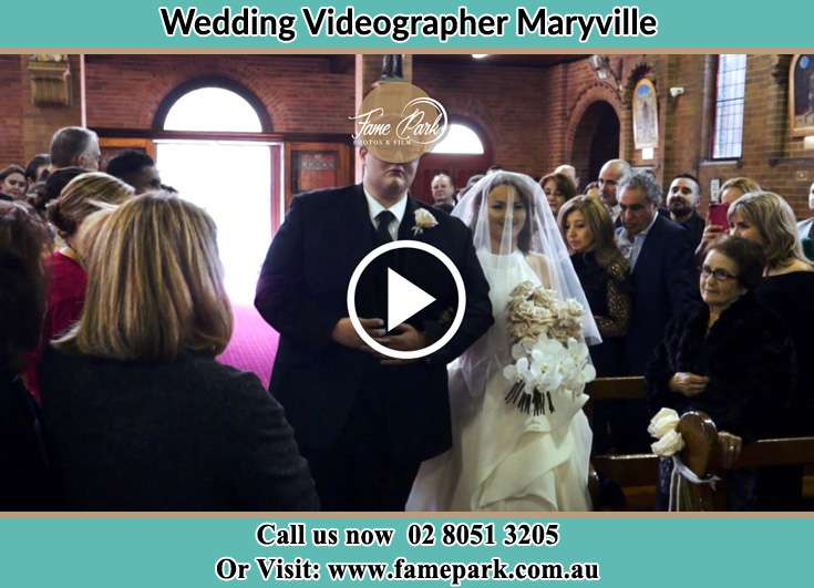 The Bride walking down the aisle with her father Maryville NSW 2293