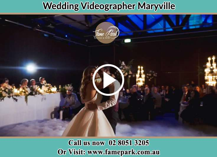 Bride and Groom looking at each other while dancing Maryville NSW 2293