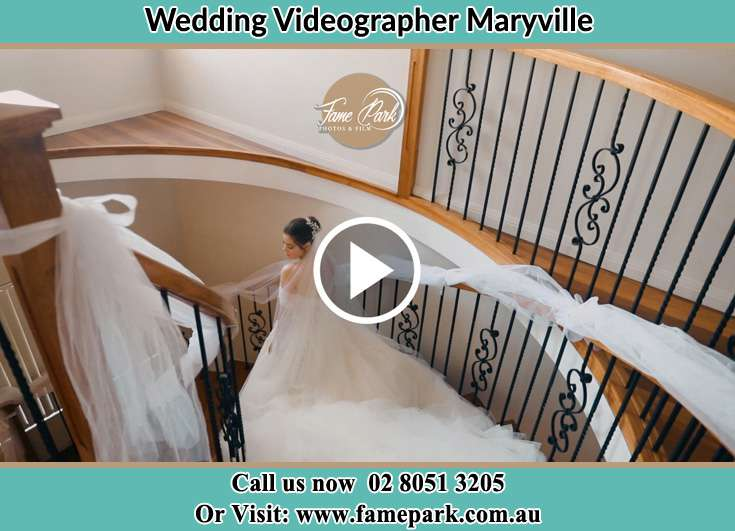 The Bride walking downstairs Maryville NSW 2293
