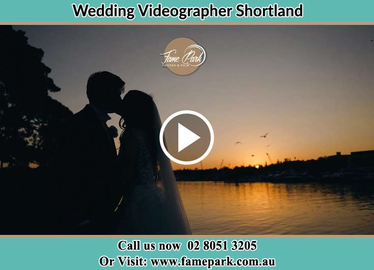 Bride and Groom kissed at the shore Shortland NSW 2307