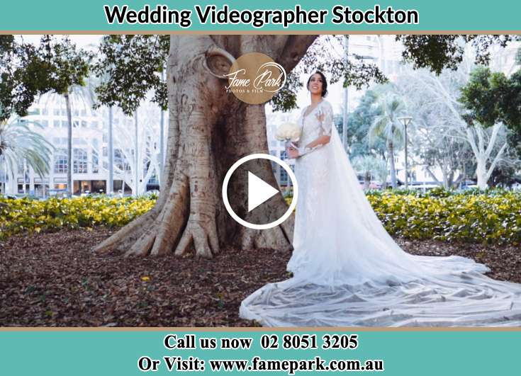The Bride posed on the camera besides the tree Stockton NSW 2295