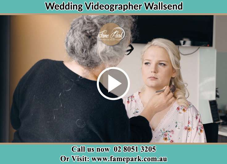 The Bride having a make-up with the help of the makeup artist Wallsend NSW 2287