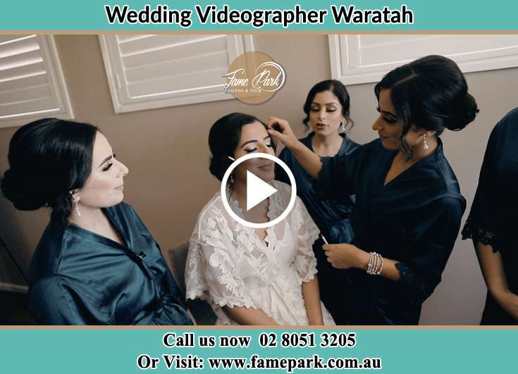 The Bride having a make-up with the help of the makeup artist Waratah NSW 2298