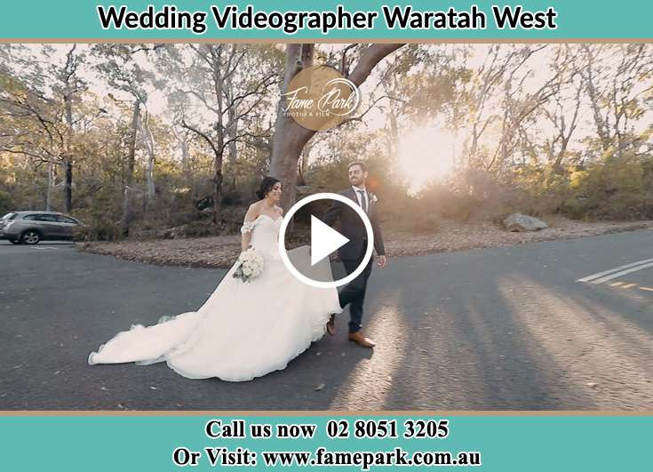 The Groom and the Bride walking in the street Waratah West NSW 2298