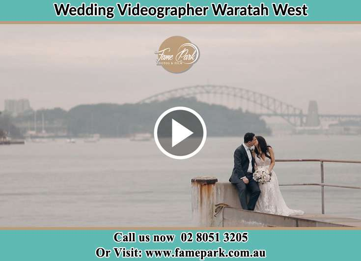 Bride and Groom kissed at the shore Waratah West NSW 2298